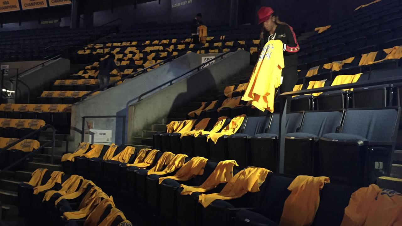 Oracle Arena turns gold as employees prepare for Game 1 of the NBA Playoffs on Friday, April 13, 2018.