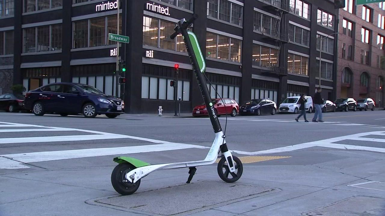 A motorized rental scooter is parked on a sidewalk in San Francisco on Monday, April 16, 2018.