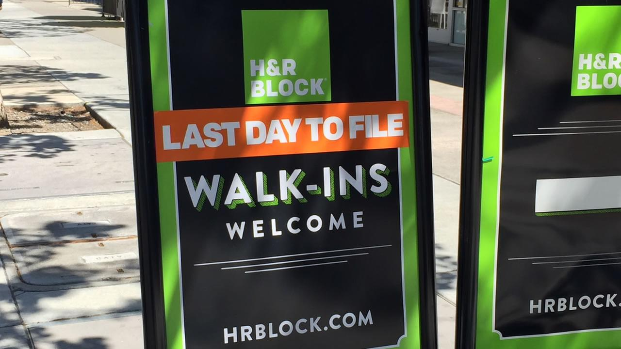 A sign welcoming walk-ins is on display in front of an H&R Block on Tuesday, April 17, 2018.