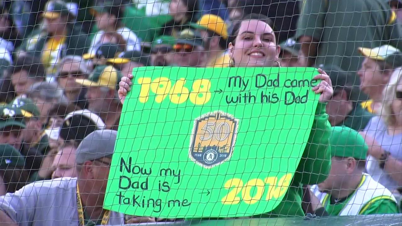 An Athletics fan holds up a sign during a game on Tuesday, April 17, 2018 in Oakland, Calif.