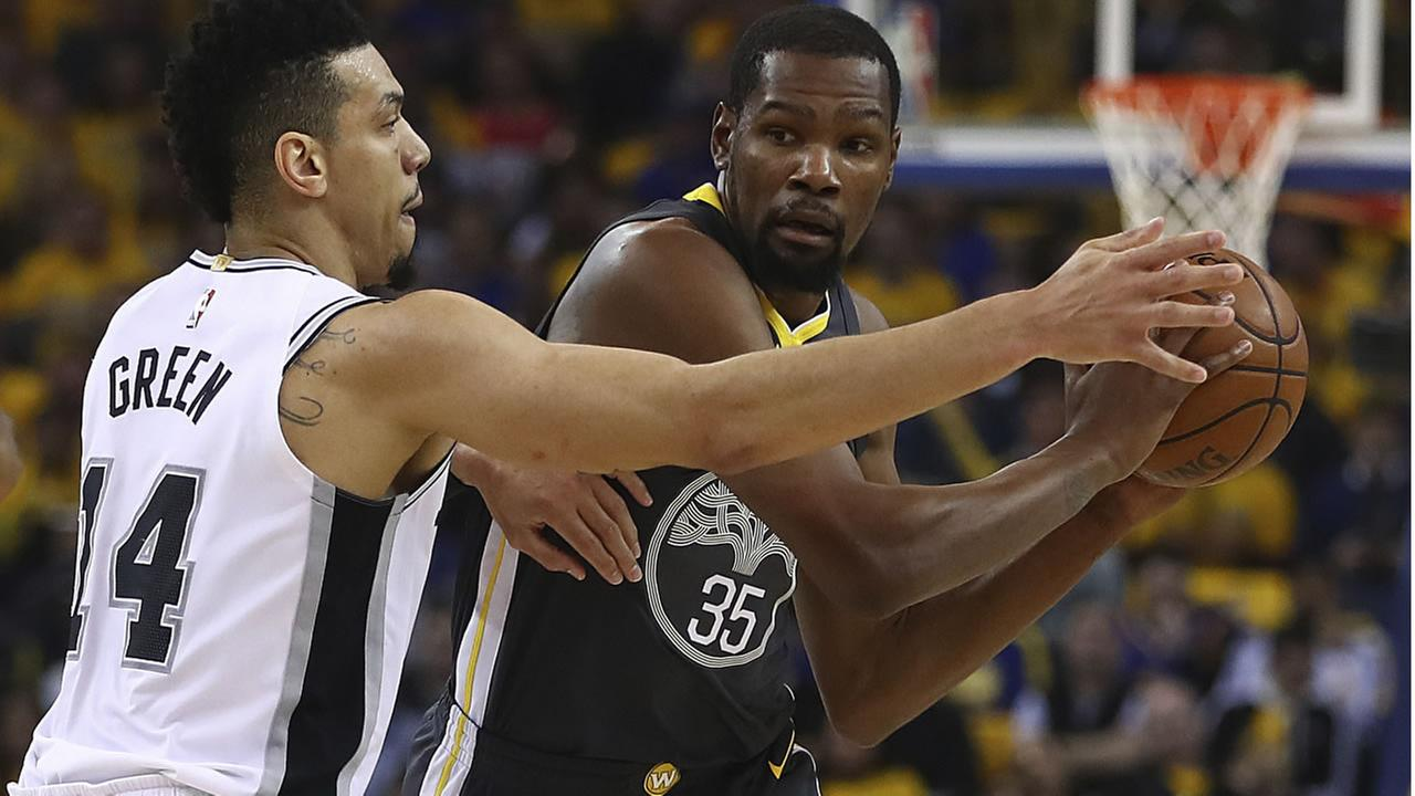 Warriors Kevin Durant is guarded by Spurs Danny Green during Game 2 of a first-round NBA basketball playoff series Monday, April 16, 2018, in Oakland, Calif. (AP Photo)