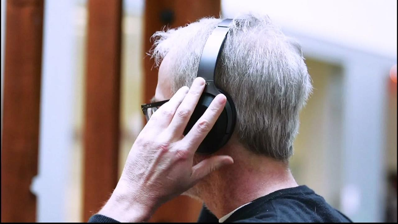 A man tries on wireless headphones in this undated file photo.