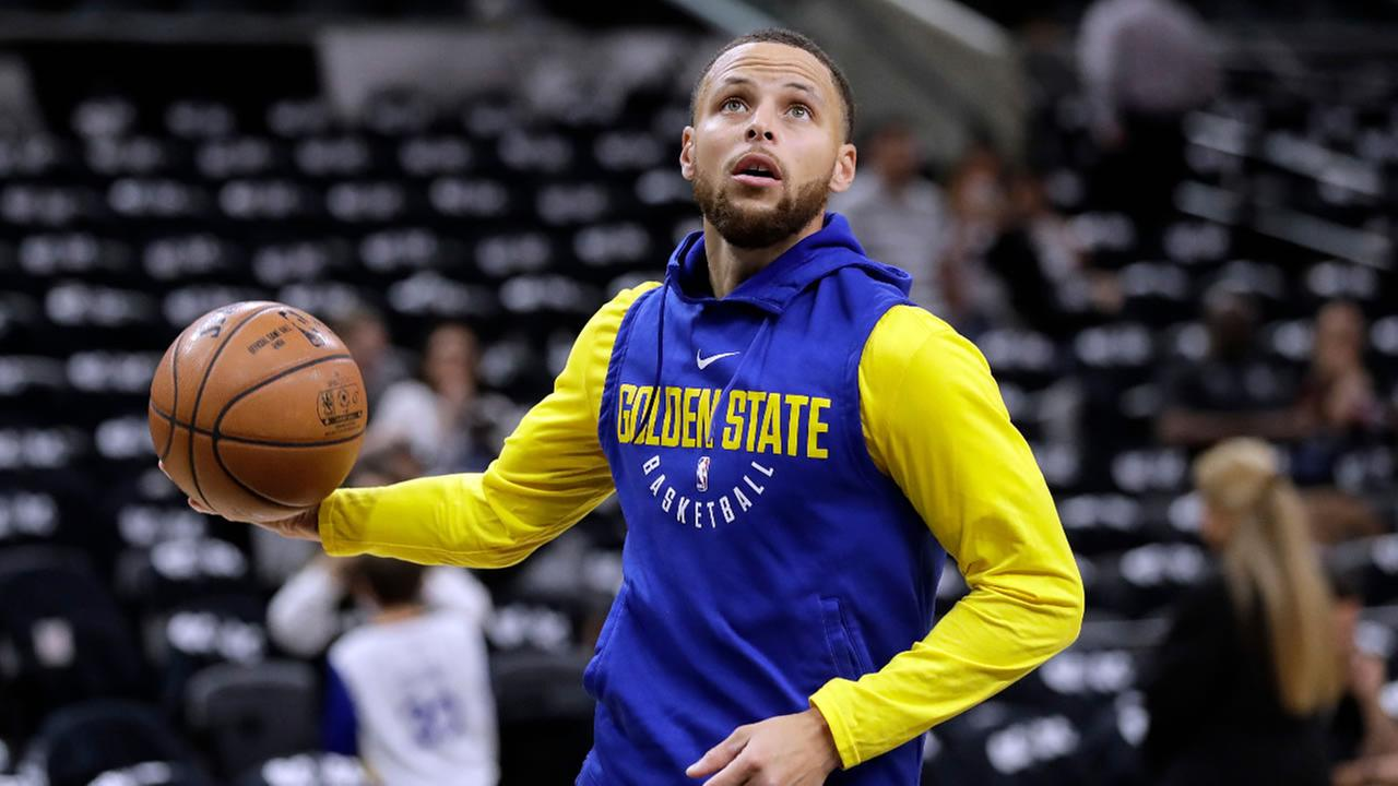 In this April 19, 2018 file photo, Warriors guard Stephen Curry warms up before Game 3 of the teams NBA basketball playoff series against the San Antonio Spurs in San Antonio.