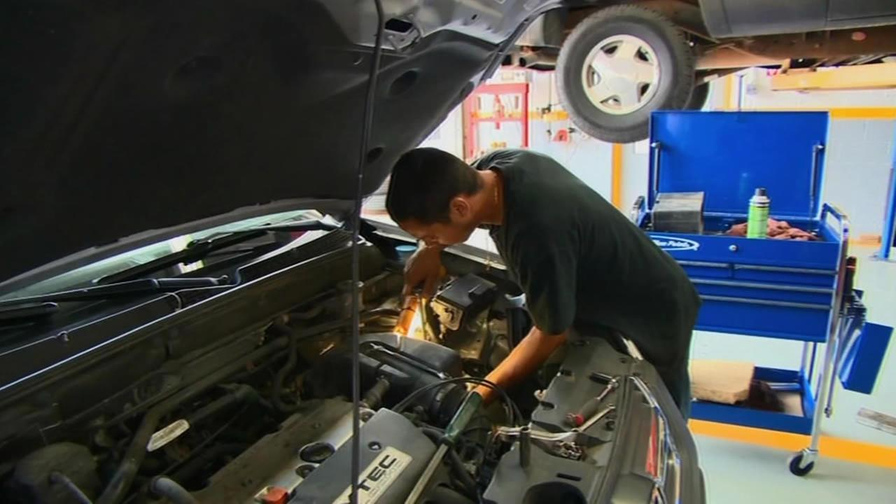 Mechanic working on a car.