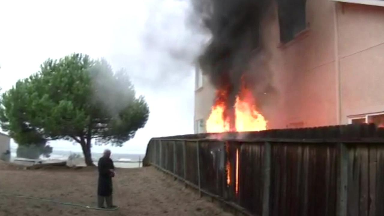 Fire crews put out a house fire in Vallejo on Tuesday, October 7, 2014.