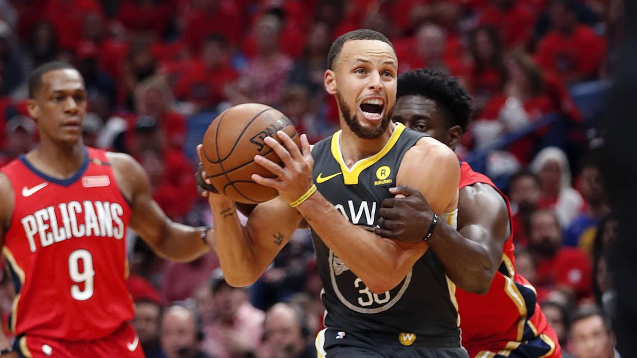 Warriors guard Stephen Curry is fouled by New Orleans Pelicans guard Jrue Holiday in New Orleans, Friday, May 4, 2018.