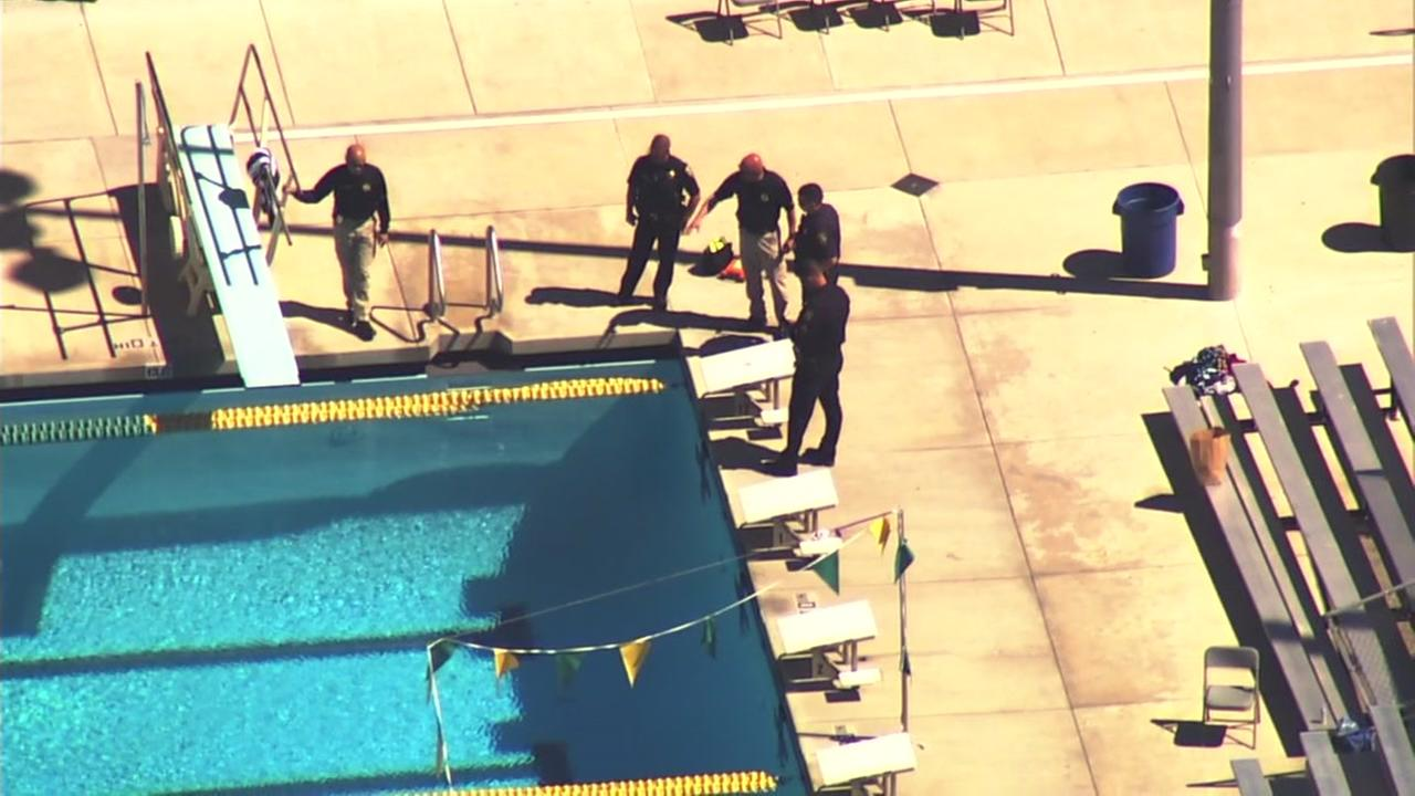 Emergency personnel are seen at the San Ramon Valley High School pool on Tuesday, May 8, 2018.