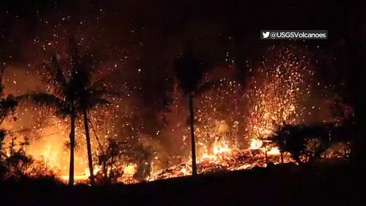 Lava spews up through palm trees in Hawaii after Kilaueas eruption in May of 2018.