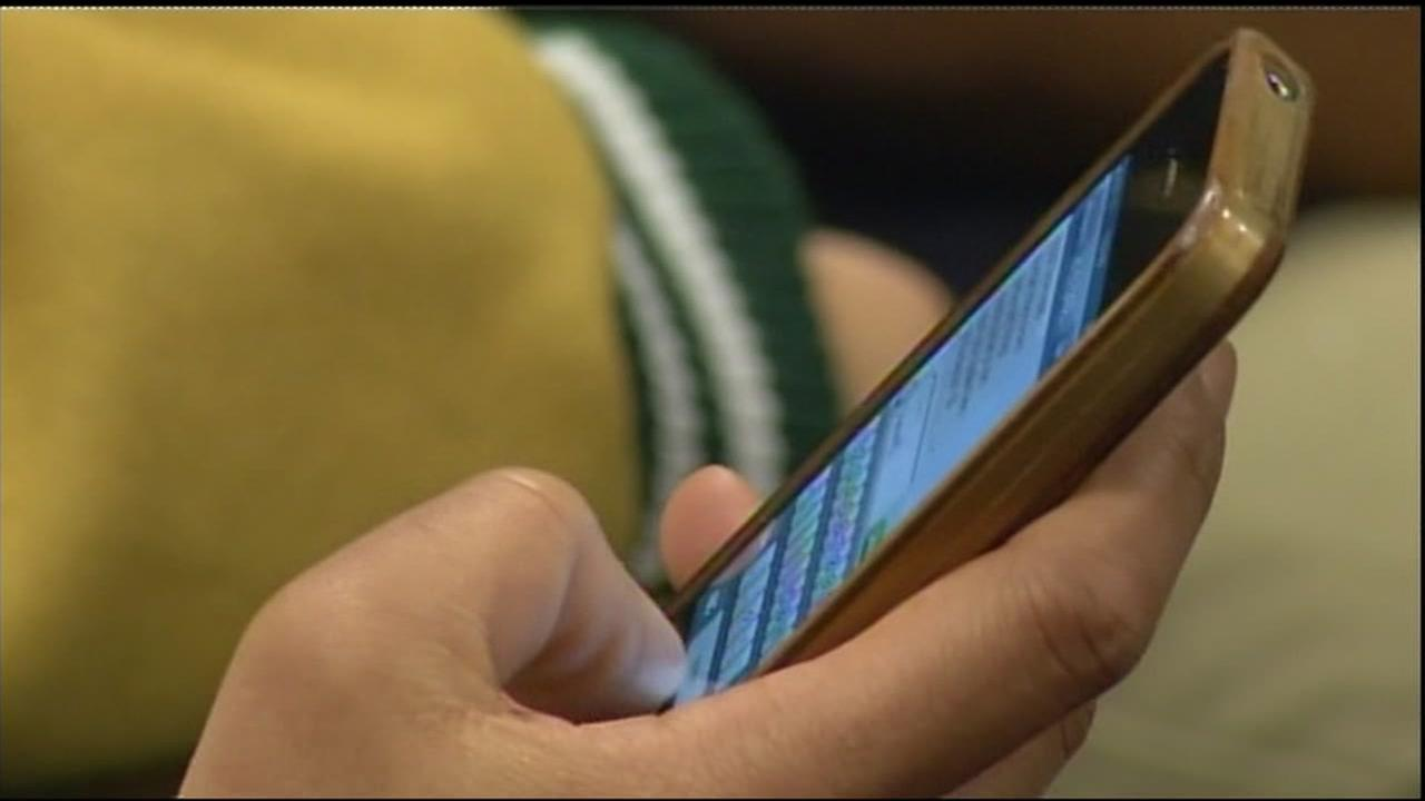 A person texts on their cellphone in this undated file photo.