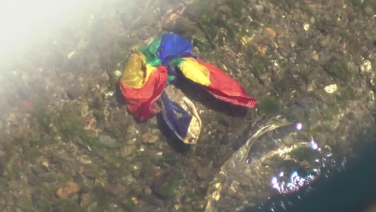 A stolen rainbow flag appears at the bottom of the Russian River in Guerneville, Calif. on Friday, May 11, 2018.