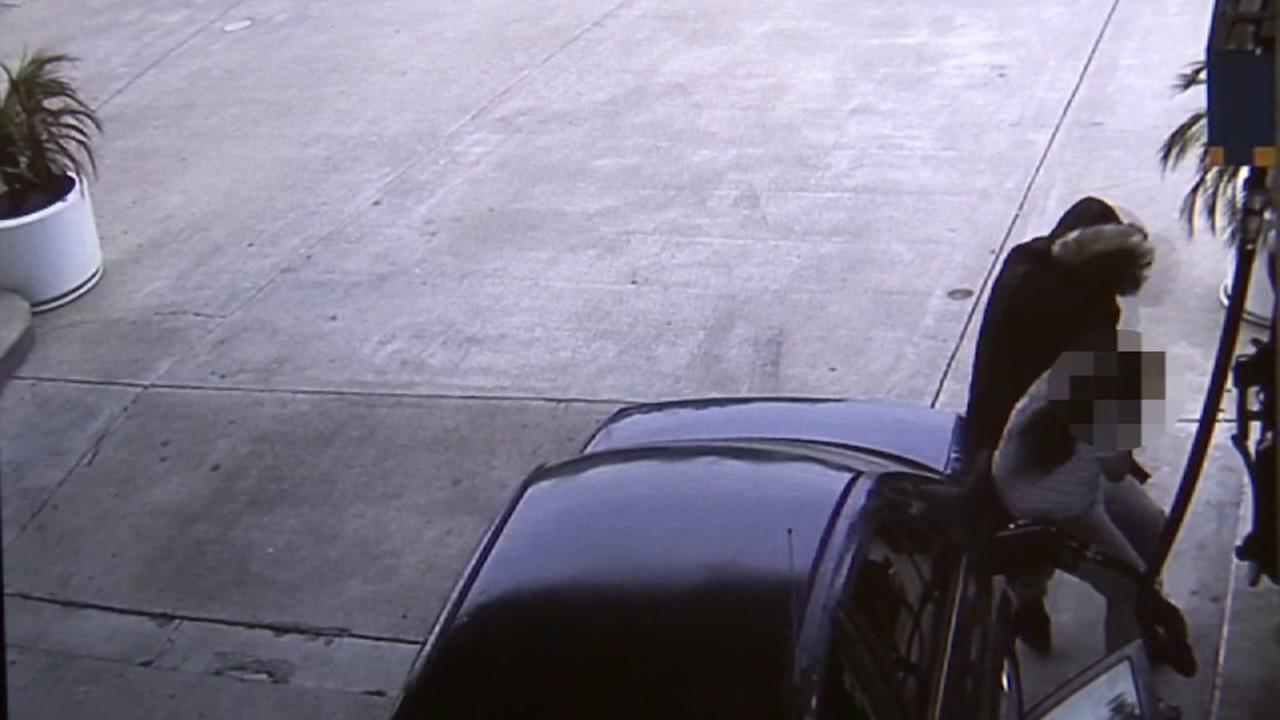 A robbery in progress is seen in Fremont, Calif.