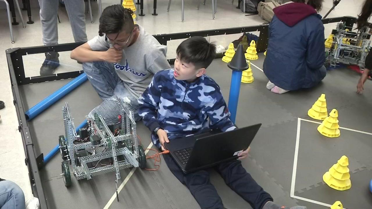Students at Willie Brown Middle School in San Francisco work on building a robot on Friday, May 18, 2018.