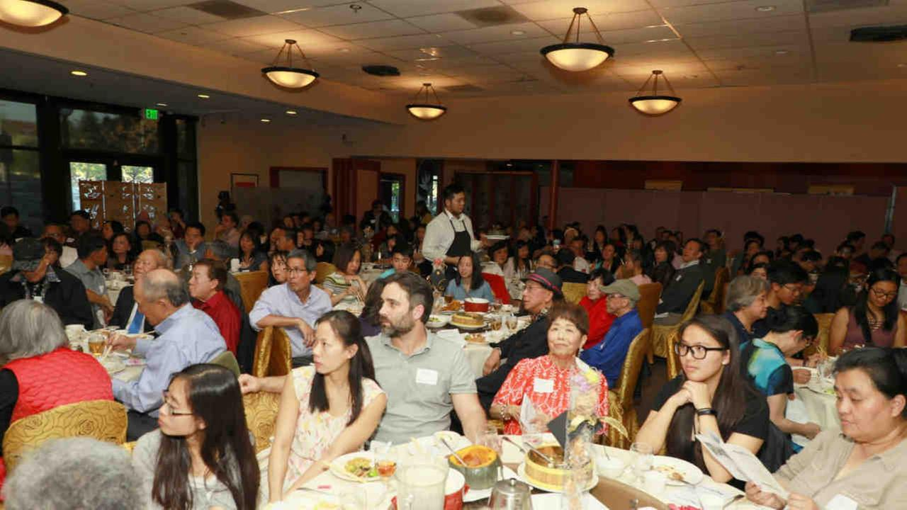 Attendees are seen at a scholarship dinner for Asian American students in Santa Clara, California.