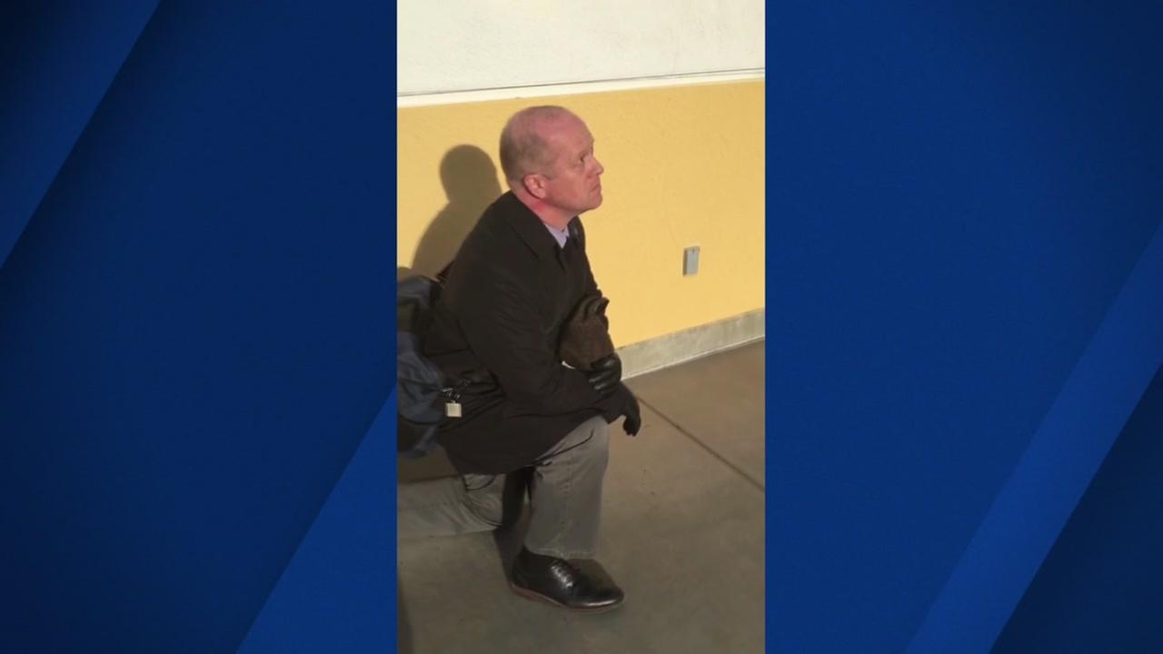 Tyler Rust, a teacher at an East Bay high school, kneels stirring controversy.