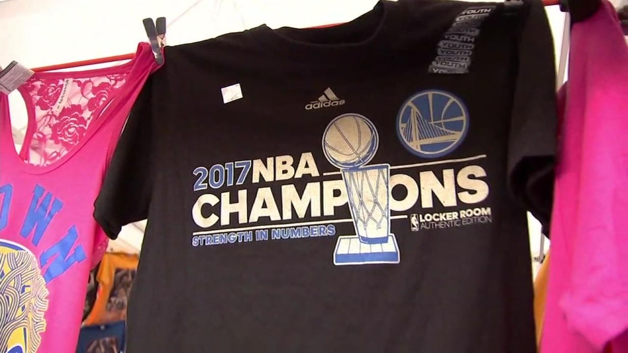 A fake Golden State Warriors shirt appears outside Oracle Arena in Oakland, Calif. on Tuesday, May 22, 2018.