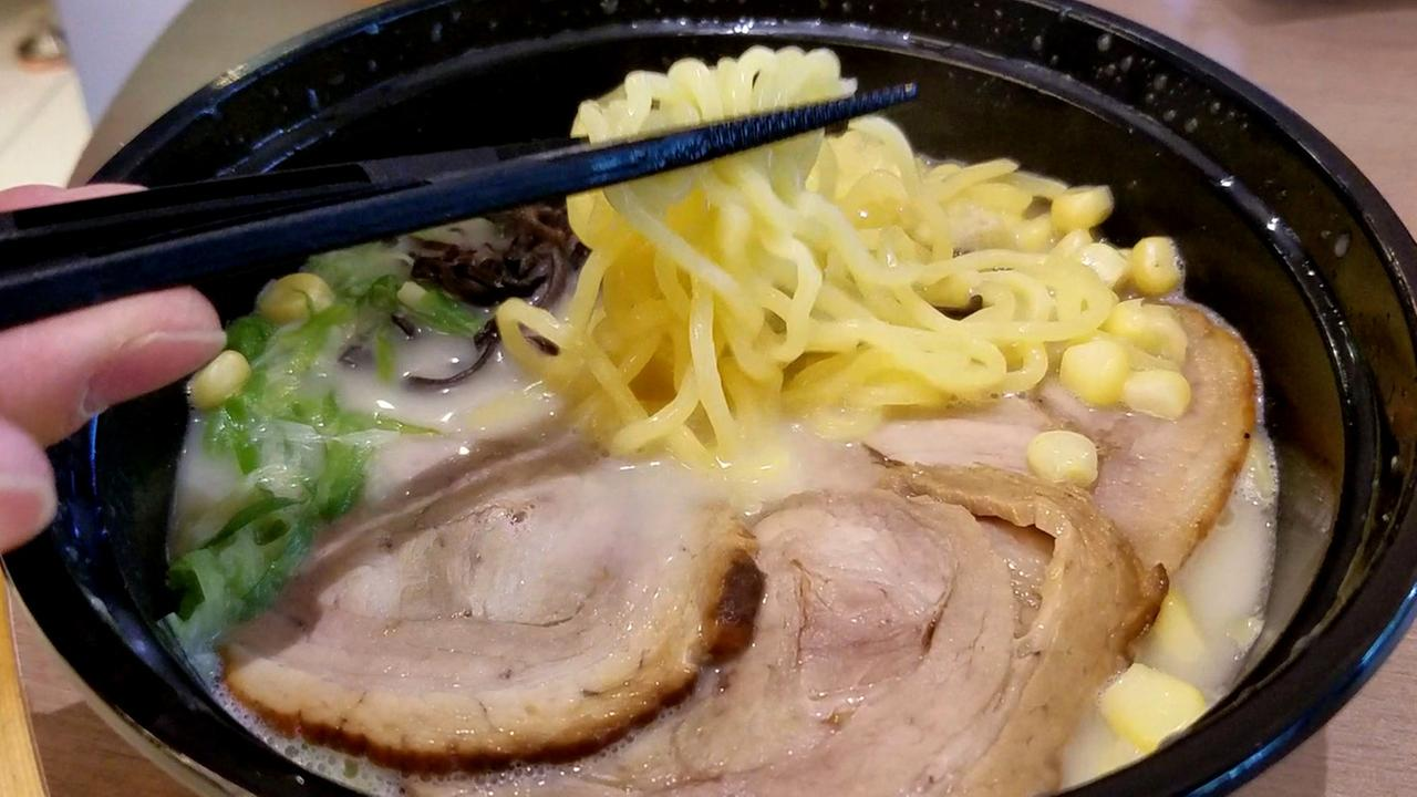 Andy Lin enjoys a hot bowl of Black Garlic Tonkotsu Ramen prepared in 45 seconds by one of his new vending machines at San Franciscos Metreon.