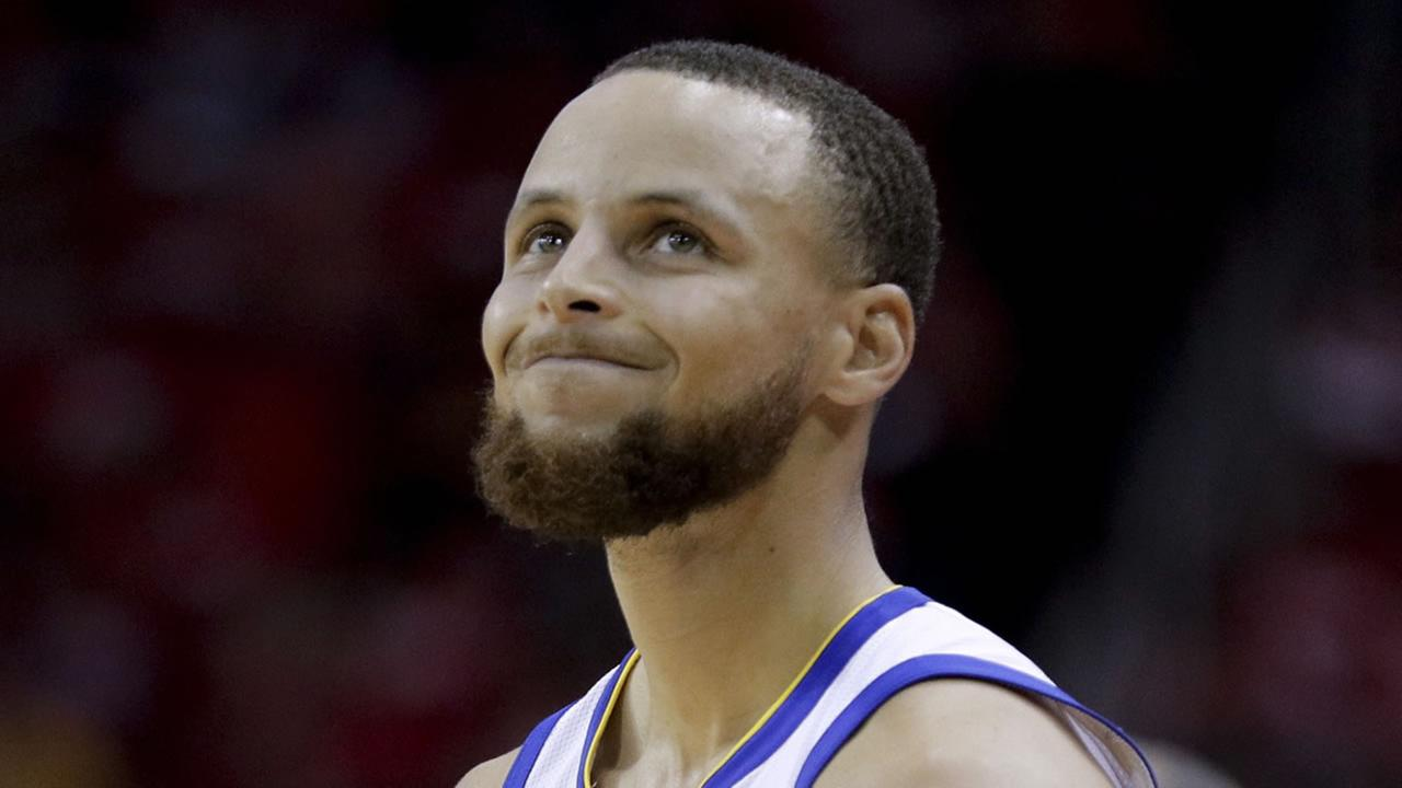 Warriors Stephen Curry reacts after getting called for a foul against the Houston Rockets during Game 5 of the Western Conference finals in Houston, Thursday, May 24, 2018.