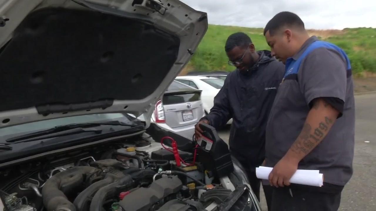 A mechanic at Fairfield Subaru looks at Giselle Garcias car on May 25, 2018.