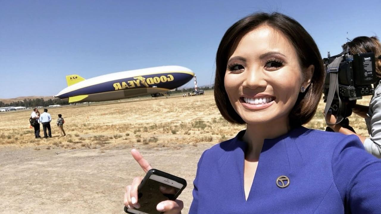 ABC7s Dion Lim poses in front of The Goodyear Blimp before taking a 100-mile ride on Friday, June 1, 2018.