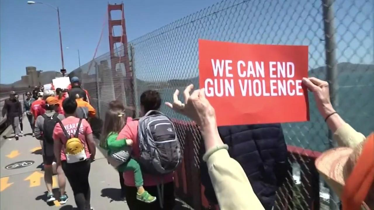 Demonstrators march across the Golden Gate Bridge for Gun Violence Awareness Day in San Francisco on June 2, 2018.
