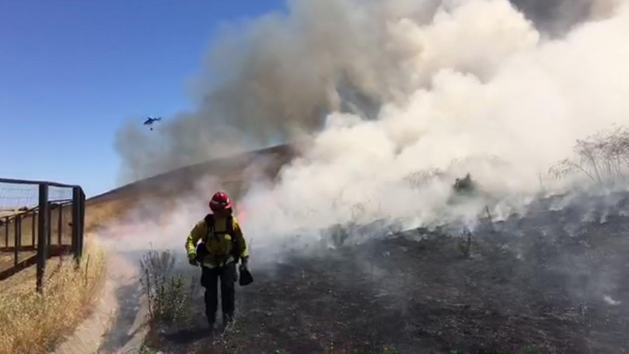 Crews battle a grass fire in Pittsburg, Calif. on Saturday, June 2, 2018.