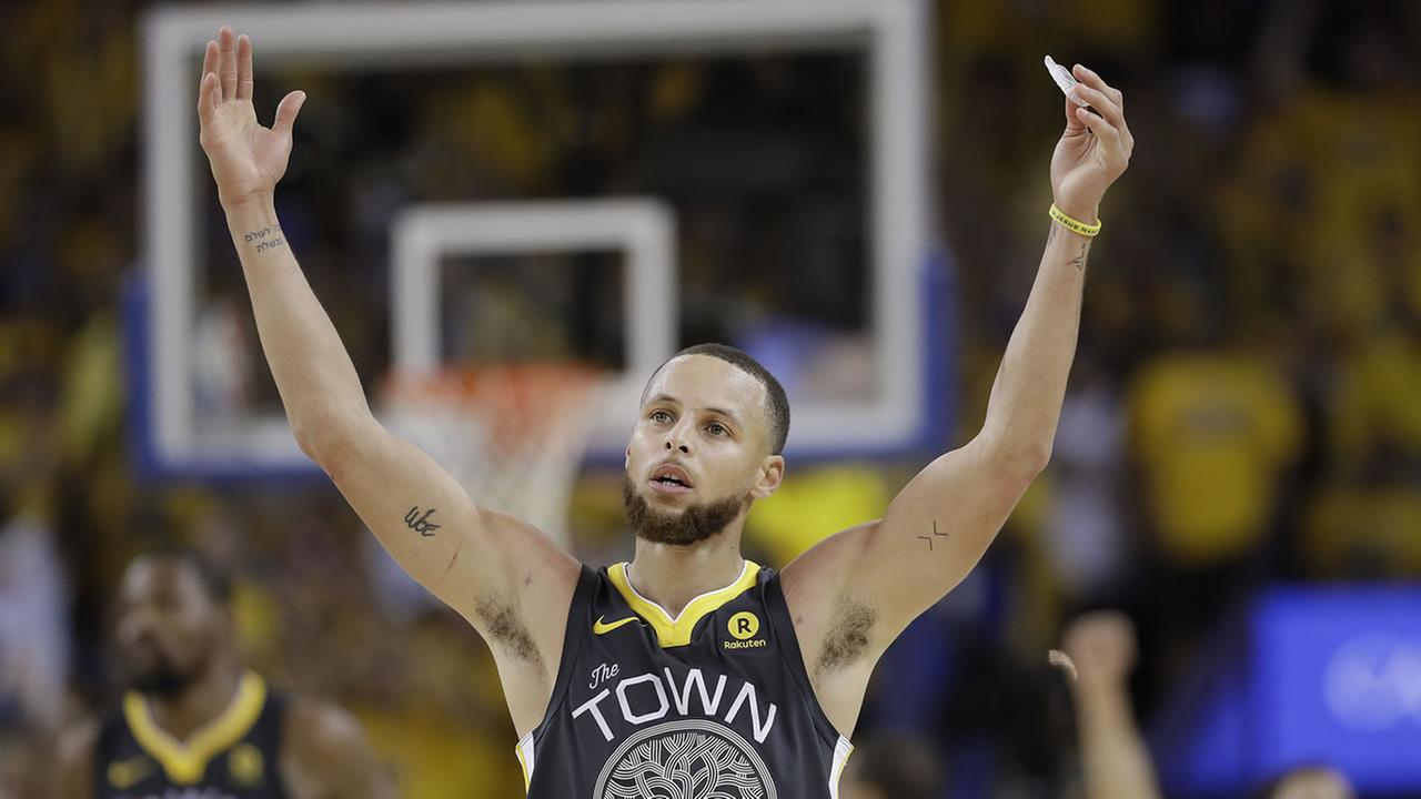 Golden State Warriors star Stephen Curry celebrates during Game 2 of the NBA Finals on Sunday, June 3, 2018.