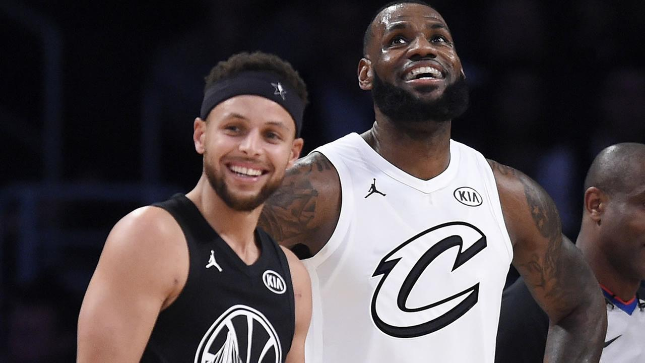 Stephen Curry and LeBron James stand together during the first half of an NBA All-Star basketball game, Sunday, Feb. 18, 2018, in Los Angeles.