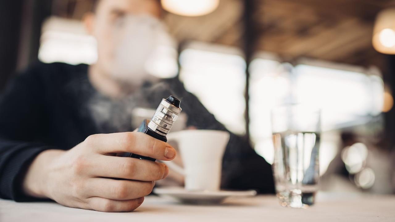 A person uses a vaping device in this undated file photo.