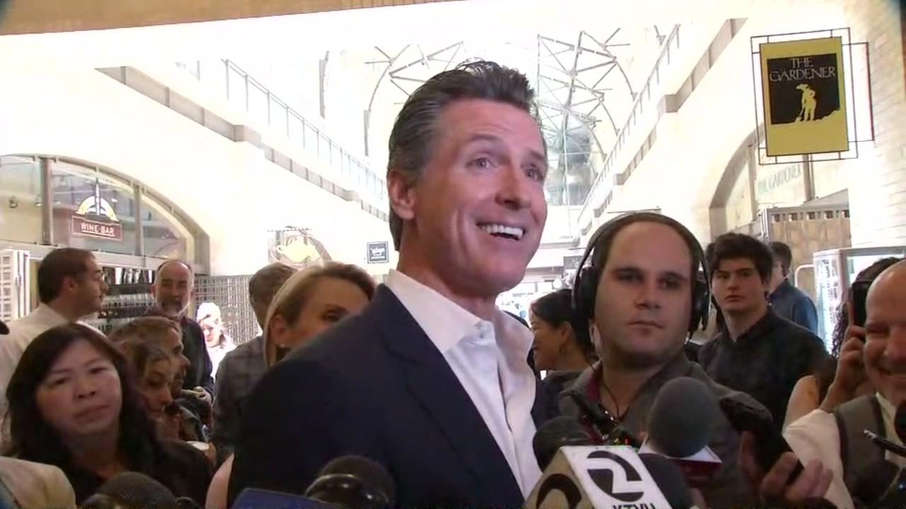 Gavin Newsom smiles as he greets the public at San Franciscos Ferry Building on Wednesday, June 6, 2018.