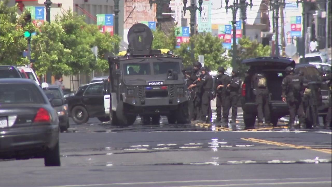 A SWAT team stands at the scene of a shooting incident in Oakland, Calif. on Friday, June 8, 2018.