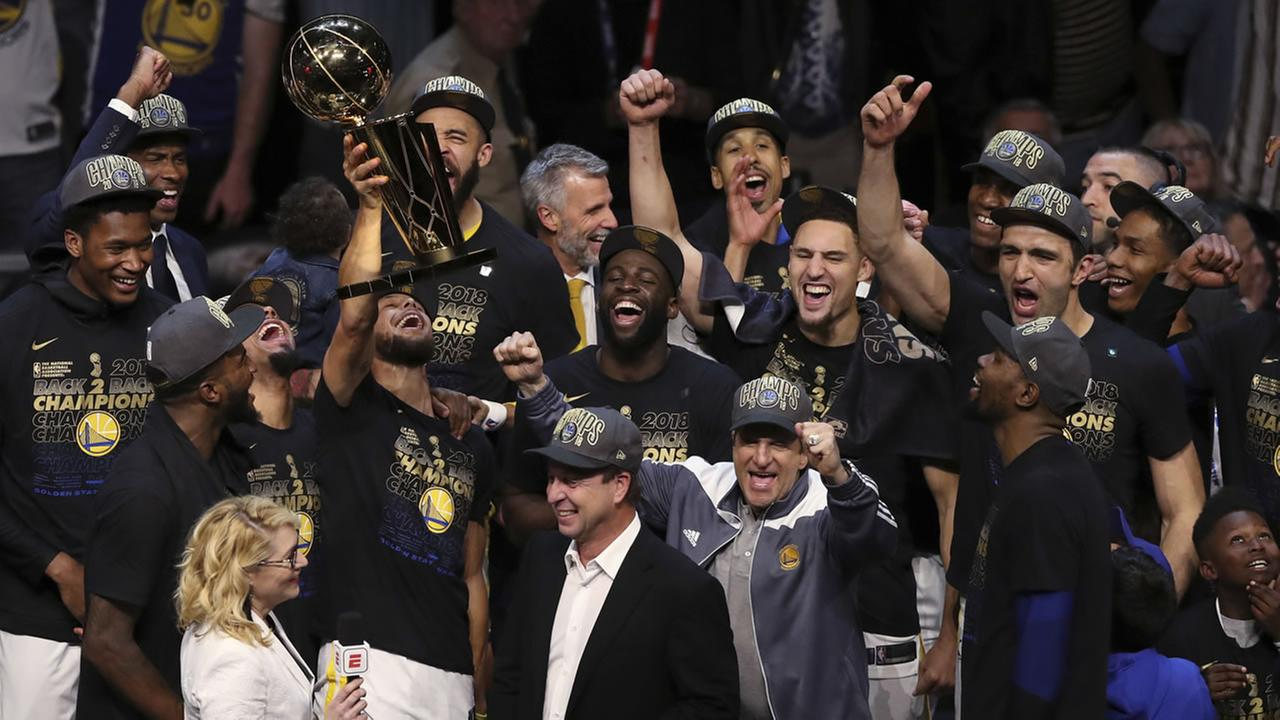 The Golden State Warriors celebrate after defeating the Cleveland Cavaliers 108-85 in Game 4 of the NBA Finals to win the NBA championship, Friday, June 8, 2018, in Cleveland.