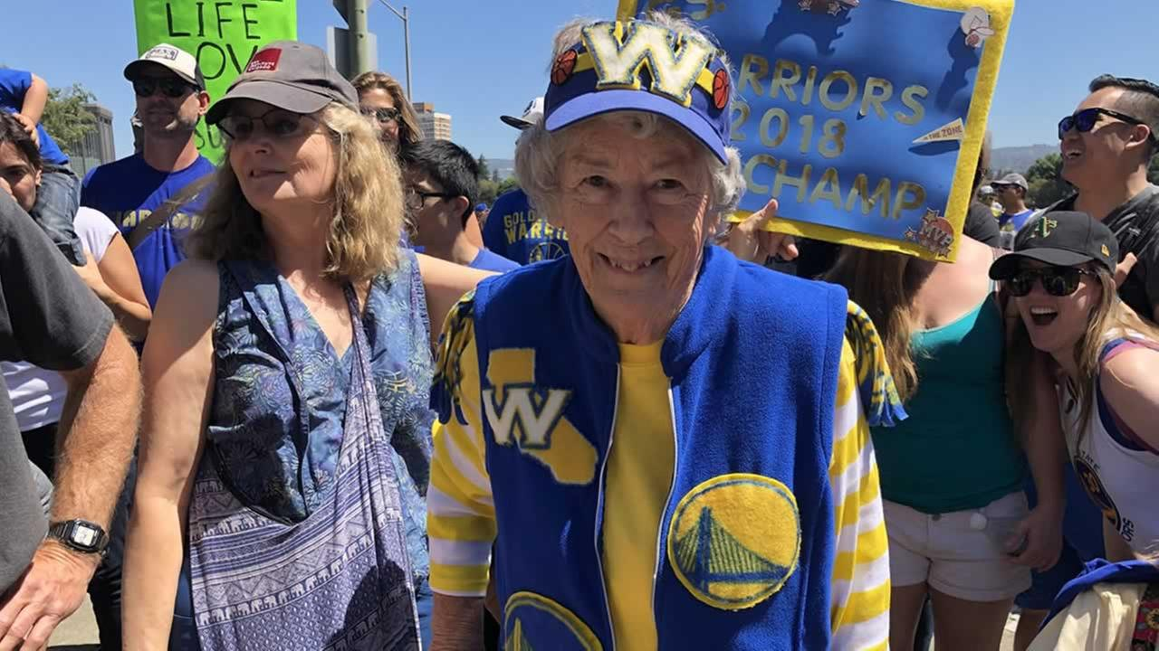 Warriors super fan, 89-year-old Audie, smiles at the Warriors victory parade in Oakland, Calif. on Tuesday, June 12, 2018.