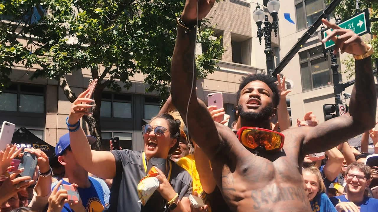 Javale McGee greets fans during the Warriors parade in Oakland on Tuesday, June 12, 2018.