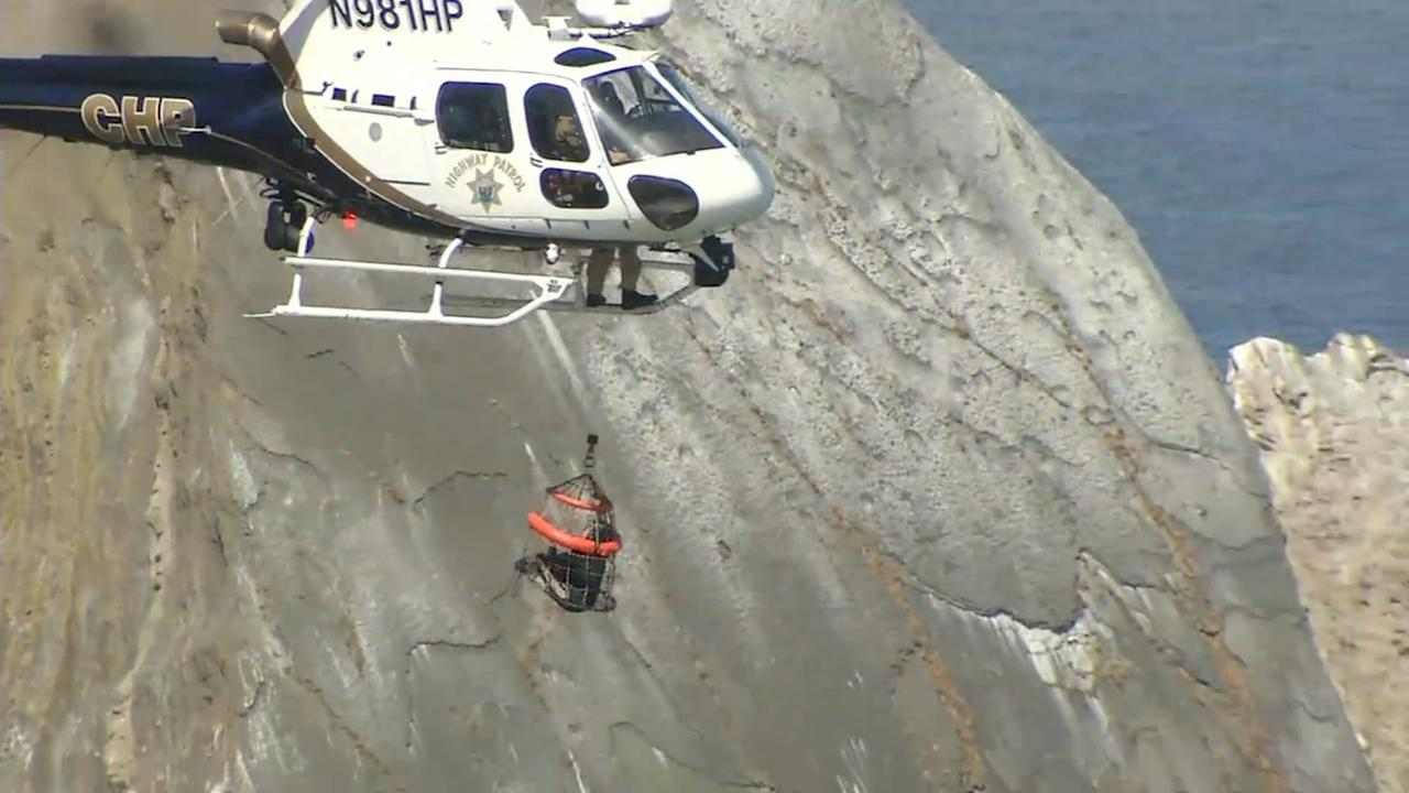 A CHP helicopter rescues a hiker who got stranded on a cliff near Pacifica, Calif., on June 16, 2018.