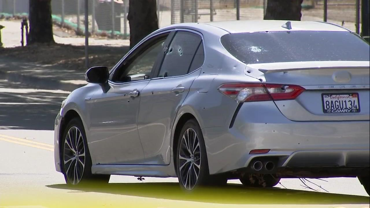 A Toyota Camry with more than 20 bullet holes on Railroad Avenue at Whipple Road in Union City, Calif. on Tuesday, June 19, 2018.