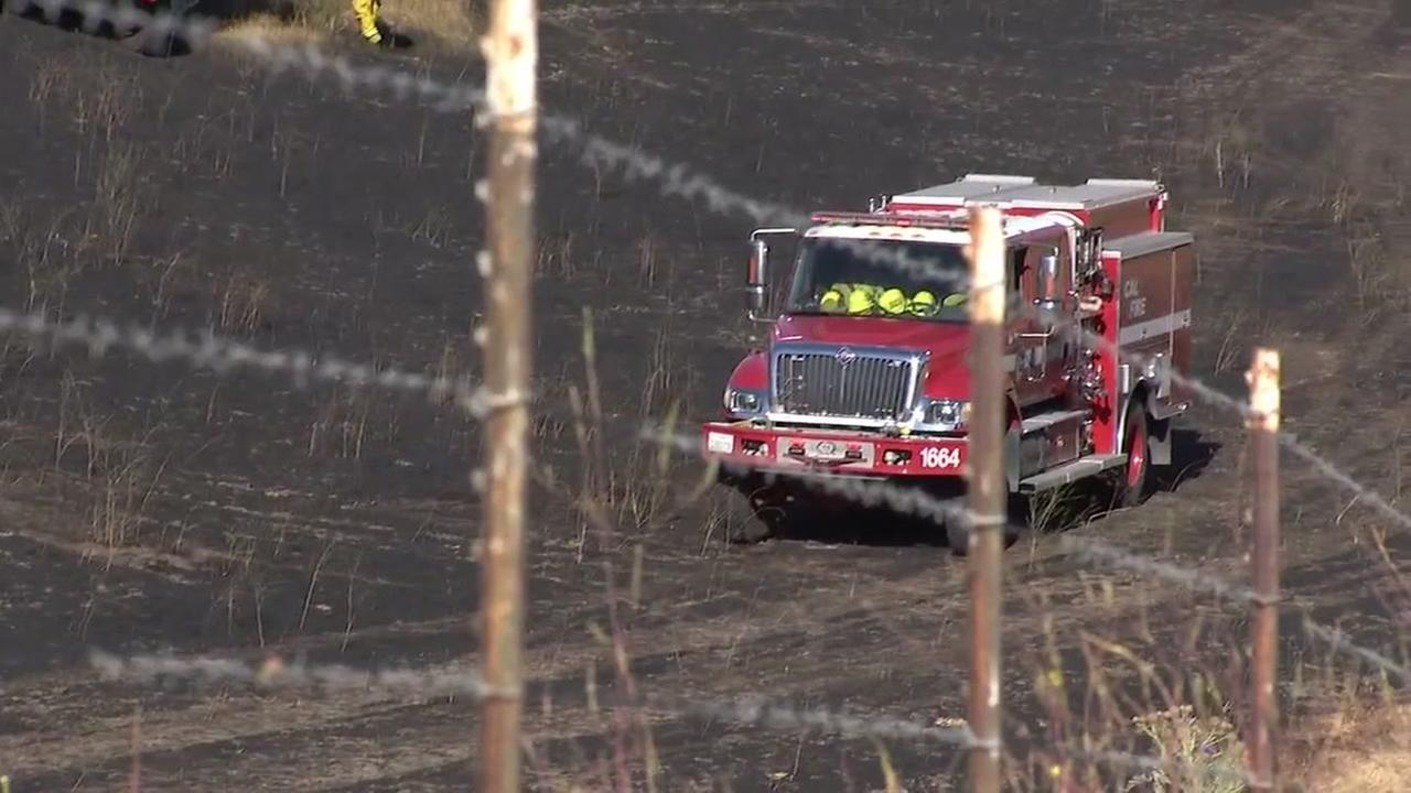 A fire truck heads up to a grass fire in San Ramon, Calif. on June 19, 2018.