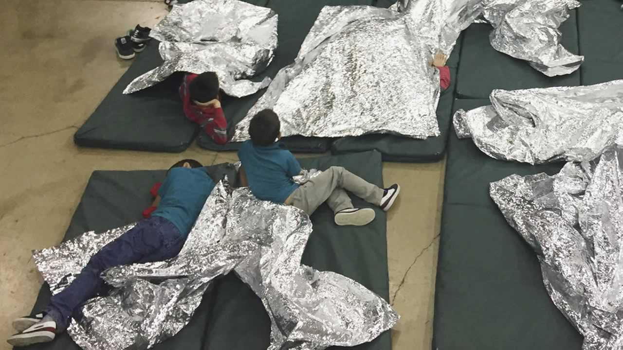 In this photo provided by U.S. Customs and Border Protection, people whove been taken into custody rest in one of the cages at a facility in McAllen, Texas, Sun., June 17, 2018.