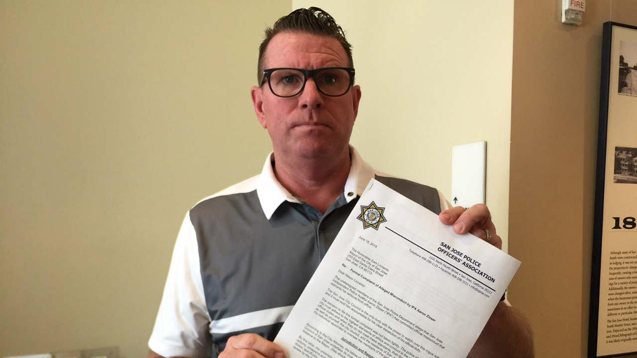 San Jose Police Officers Association President Paul Kelly is seen with a letter to the citys mayor in San Jose, Calif. on Monday, June 25, 2018.