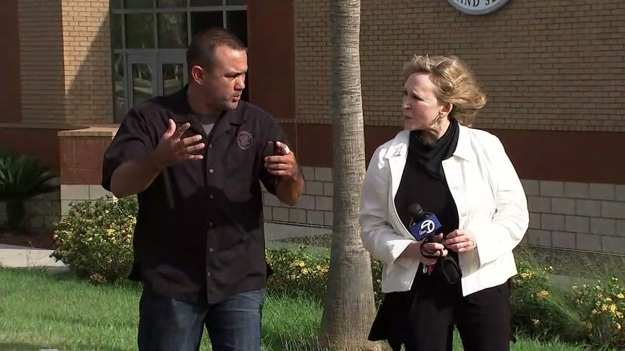 Cheryl Jennings interviews a border patrol officer in McAllen, Texas.