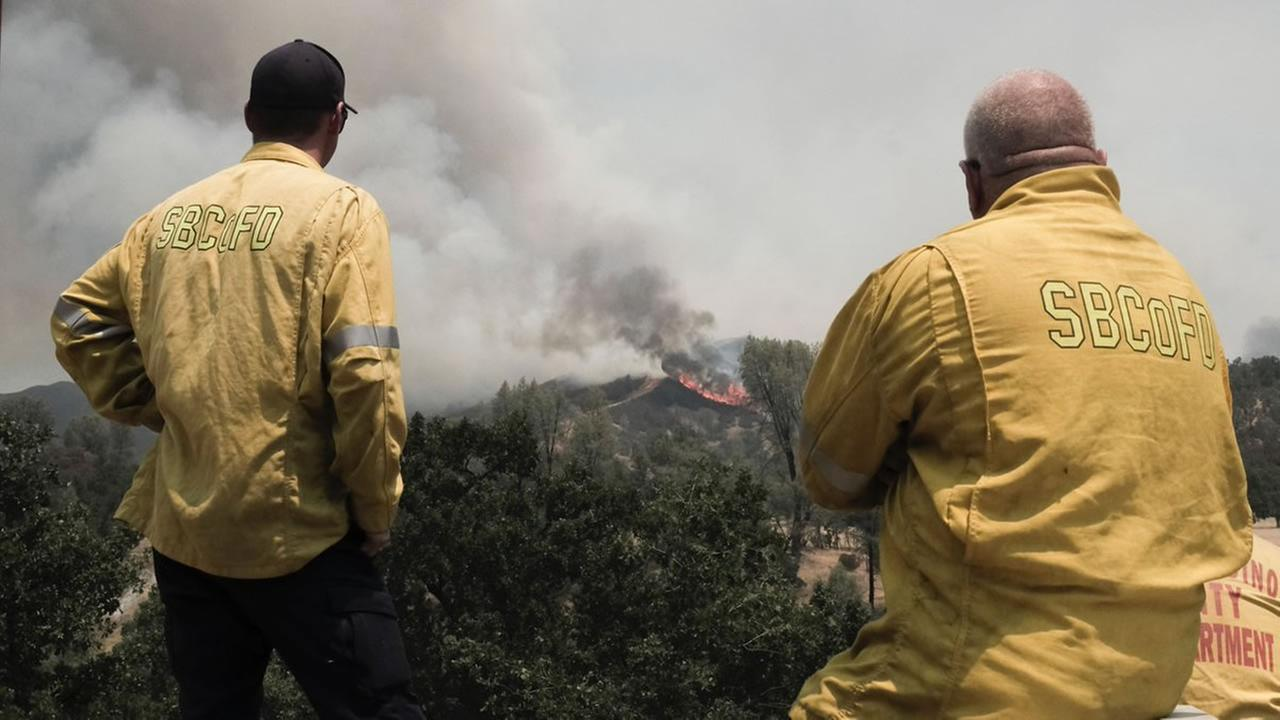 Firefighters battle the Pawnee Fire in Lake County, Calif. on Tuesday, June 26, 2018.