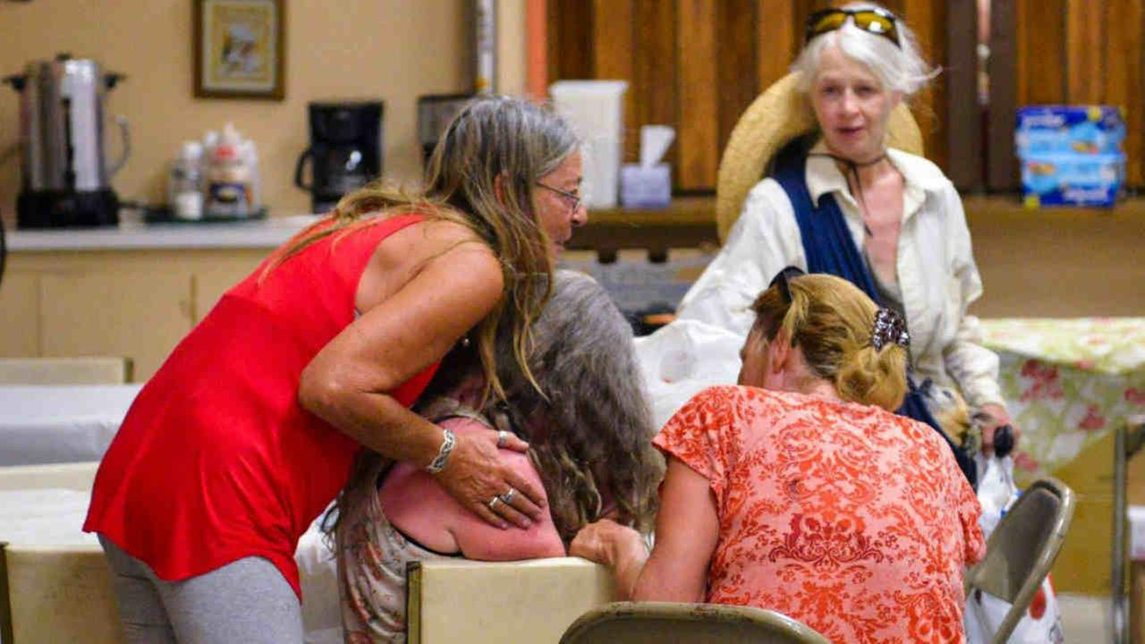 An evacuee is seen being consoled in a shelter in Clearlake Oaks, Calif. on Wednesday, June 27, 2018.