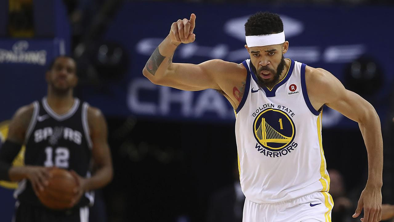 Warriors JaVale McGee celebrates a score during Game 1 of a first-round NBA basketball playoff series Saturday, April 14, 2018, in Oakland, Calif.