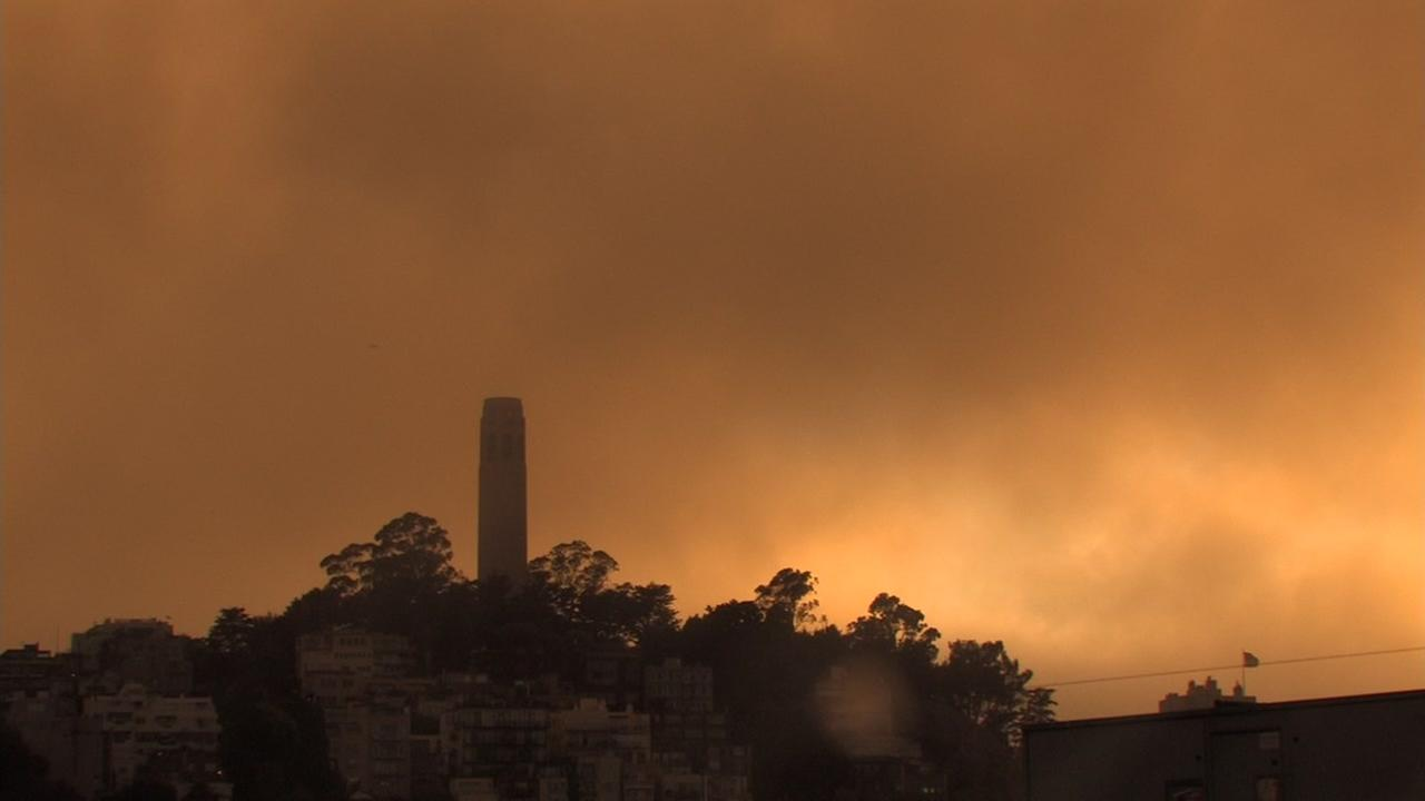 Coit Tower is bathed in a hazy orange light in San Francisco on Saturday, June 30, 2018.