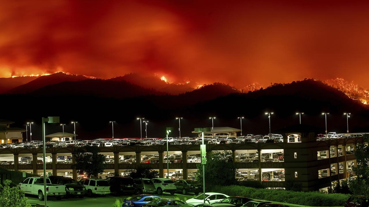 Flames from the County fire burn above Cache Creek Casino Resort on Saturday, June 30, 2018, in Capay, Calif.