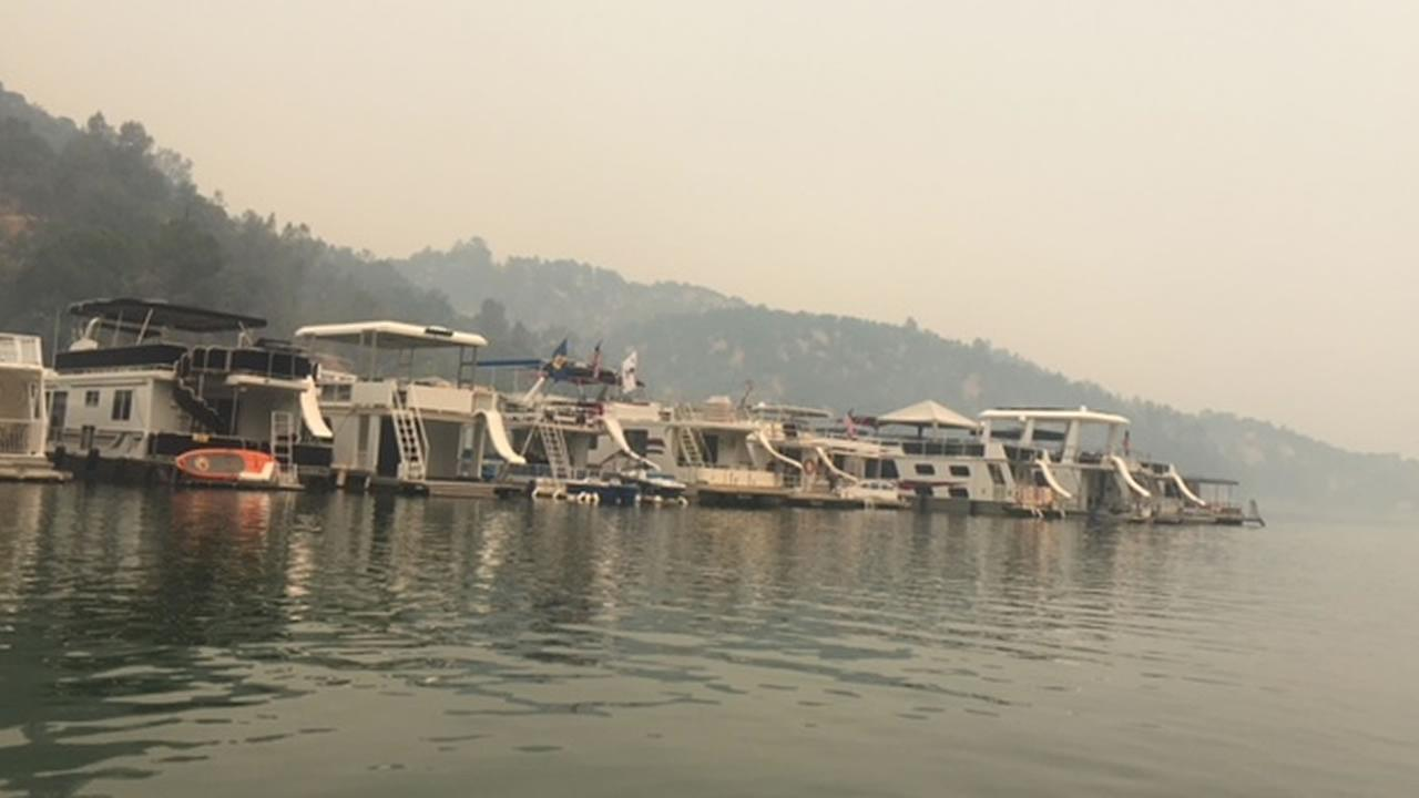 The marina at Markley Cove on Lake Berryessa is nearly deserted, most of the boats still in their slips, a thick smog in the air on Monday, July 2, 2018.