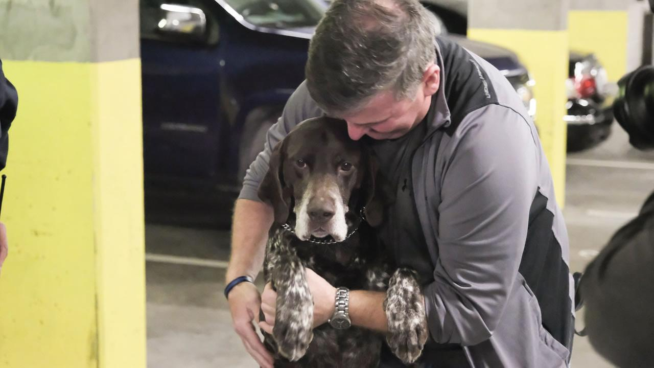 Val Kirwin and his beloved police dog Baro appear in San Francisco after being reunited on Monday, July 2, 2018.