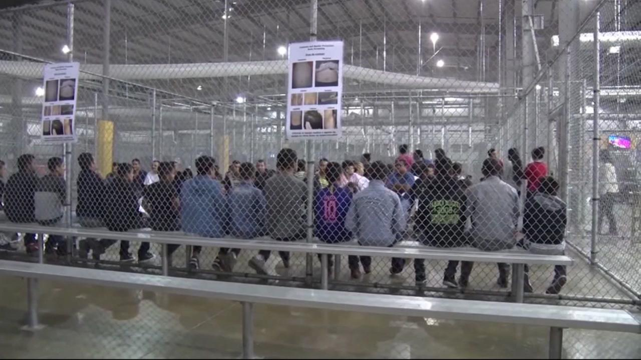 Children appear at the border in a detention facility in this undated image.
