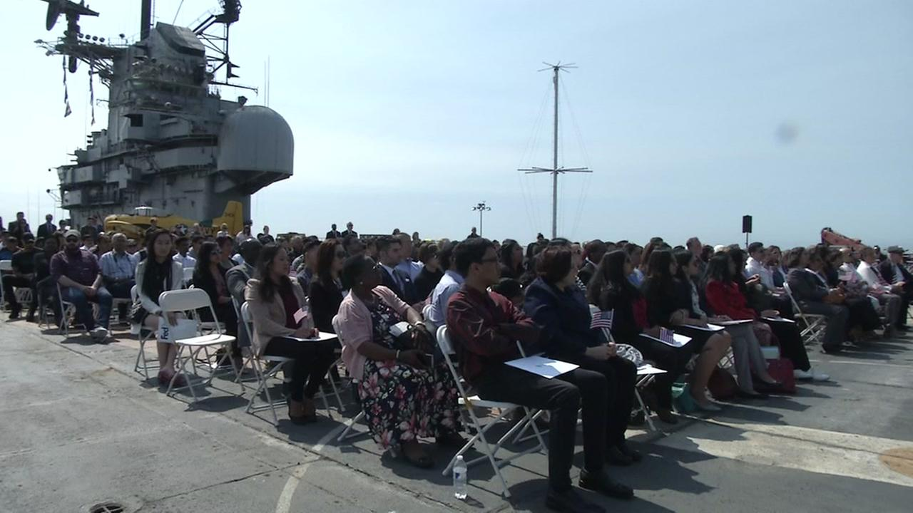 New citizens are sworn in aboard the U.S.S. Hornet in Alameda, Calif. on Tuesday, July 3, 2018.