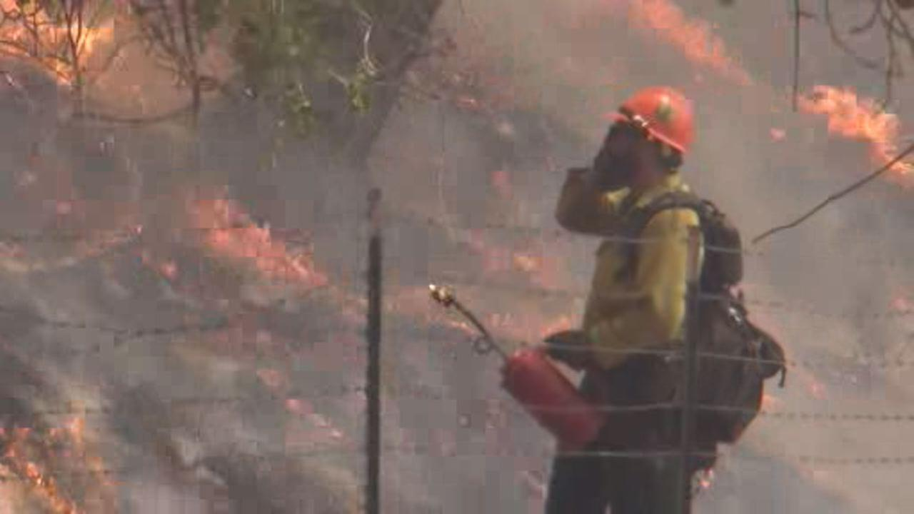 This undated image shows firefighter battling County Fire in Yolo and Napa counties.