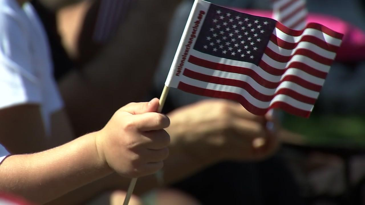 A child holds an American Flag on the 4th of July in San Jose, Calif.